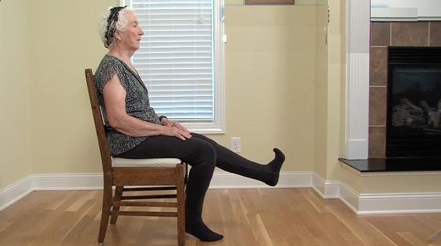 Older adult doing PT assessment exercises