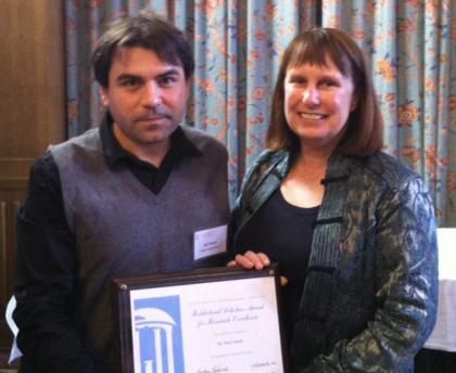 Nuri Ozturk receives award from VC Barbara Entwisle