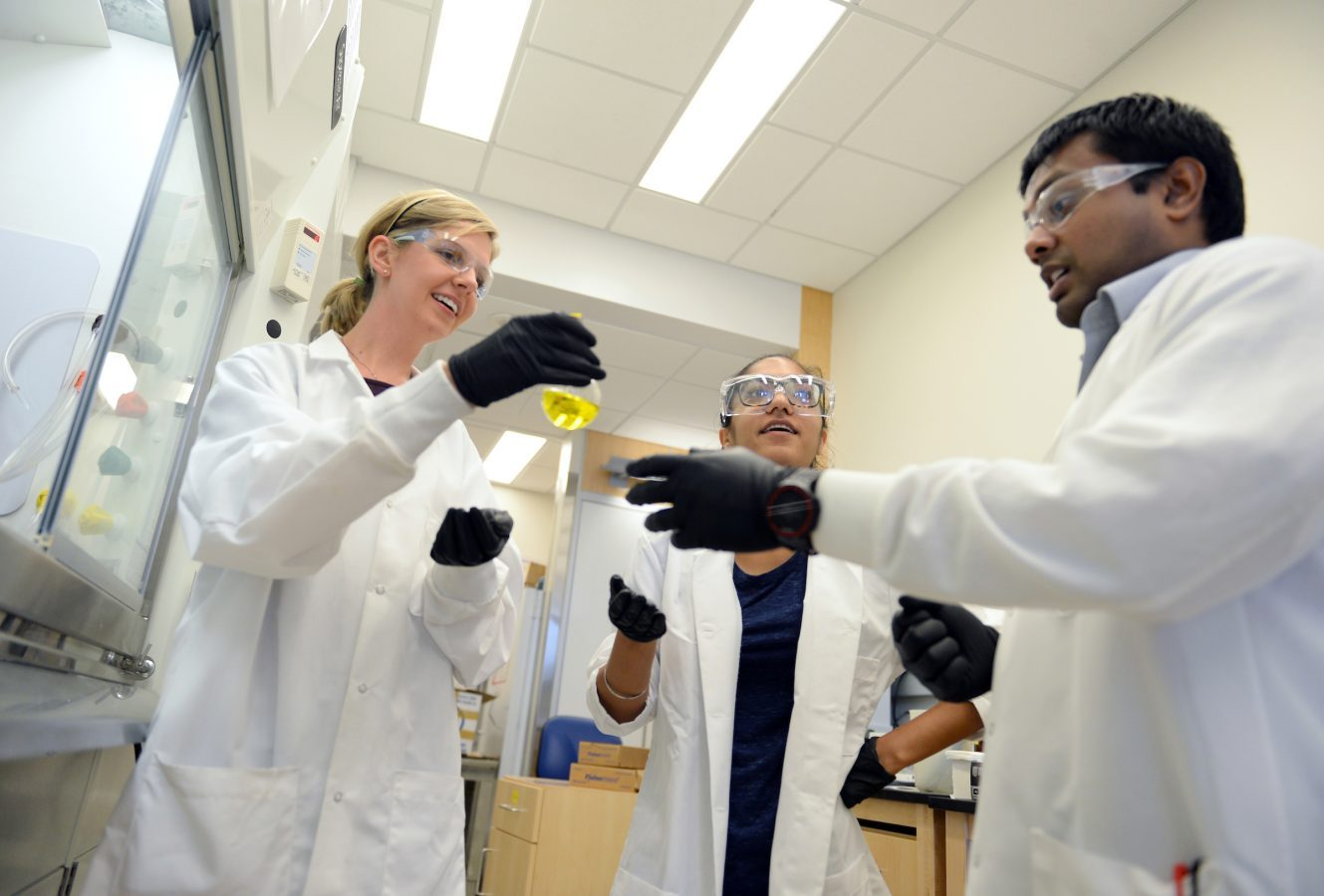 photo of 3 people Postdoctoral student Sarah Scarry, graduate student Manwika in lab Give Now to Lab Operations at UNC