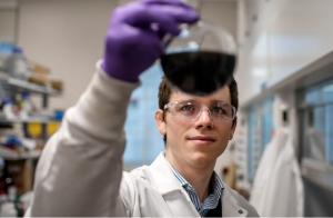 photo of man scientist image holding a beaker