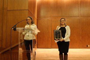 photo of Carolyn M. Clabo receives award from Beverly Errede PhD at 2018 holiday party