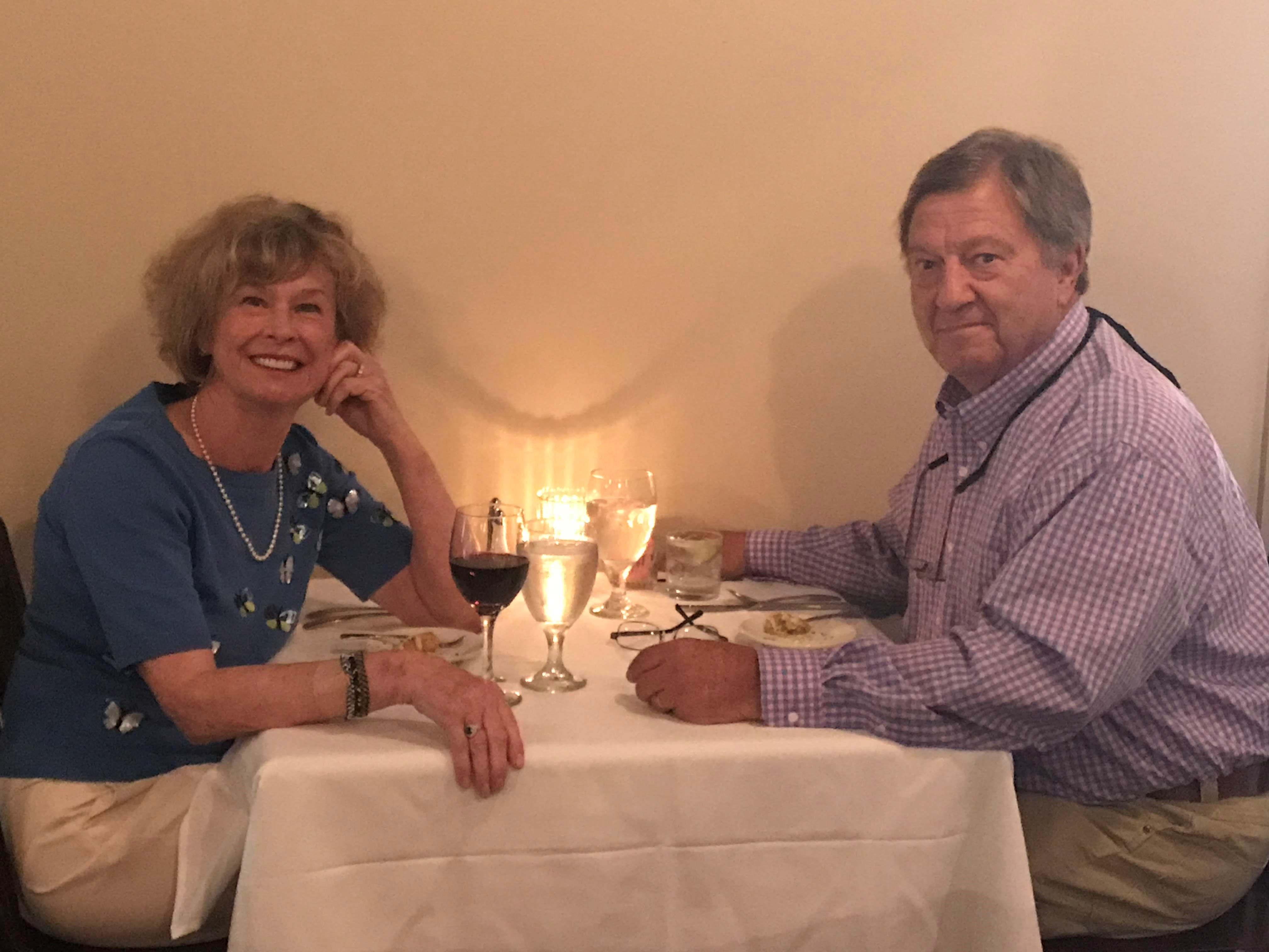 Two alumni sitting at a table over dinner Jeanie VanWinkle PhD and Barry VanWinkle PhD This photo taken in 2017 on Barry's birthday
