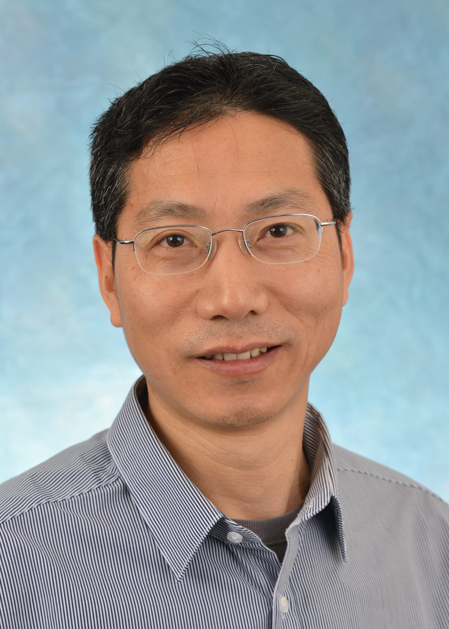 photo of Guochun Jiang PhD, Assistant Professor of Biochemistry and Biophysics Joint appointment in UNC HIV Cure Center (photo credit: Paul Braly of Tarheel Images)