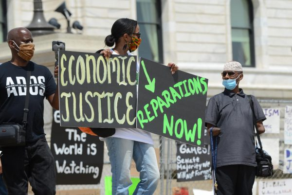 Hundreds gathered outside the Minnesota capitol building in St. Paul on June 19, 2020 to demand reparations from the United States government for years of slavery, Jim Crow, segregation, redlining, and violence against Black people from police.