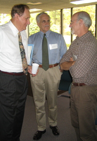 Physiology's Dr. James Faber (at right) speaks with Dr. William Greenlee (center), President and CEO of The Hamner Institutes, and Dr. Charles Hamner (left), Chairman of the Hamner's Board of Trustees.
