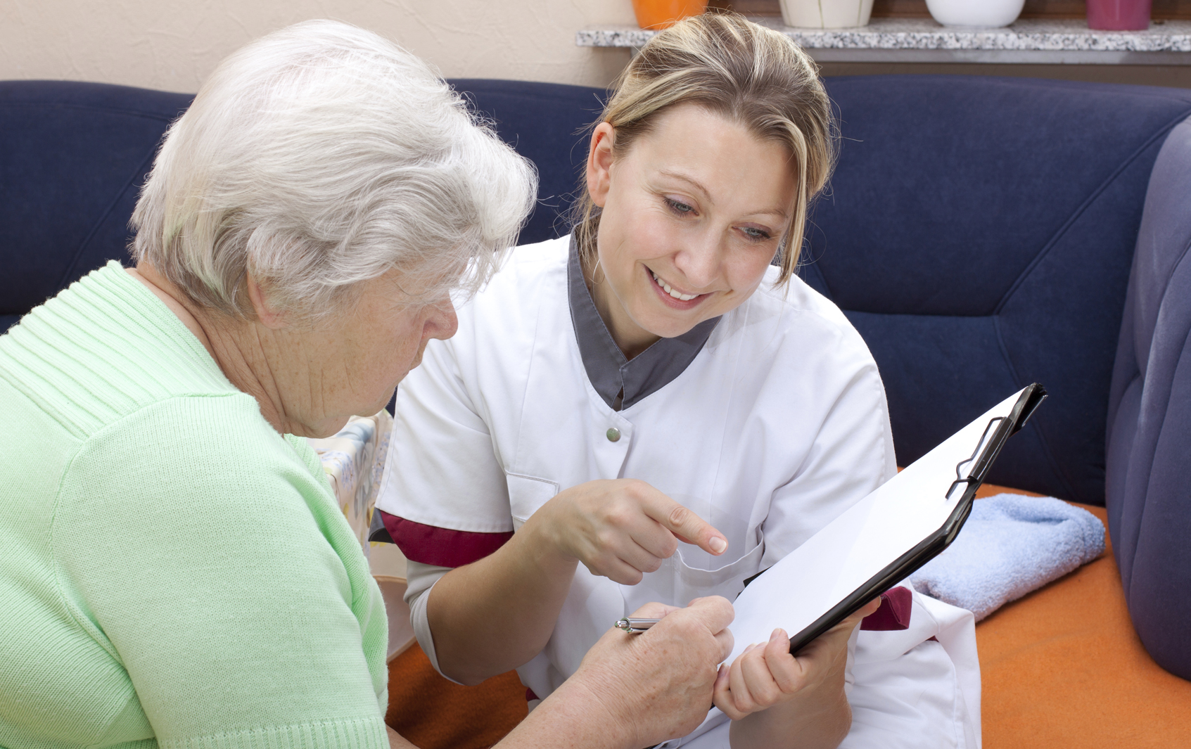 Patient speaking with research assistant