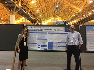 UNC at American Society for Microbiology Research Assistant Ashley Boshe and David van Duin, MD, PhD, stand with their poster during the 2017 American Society for Microbiology meeting in New Orleans.