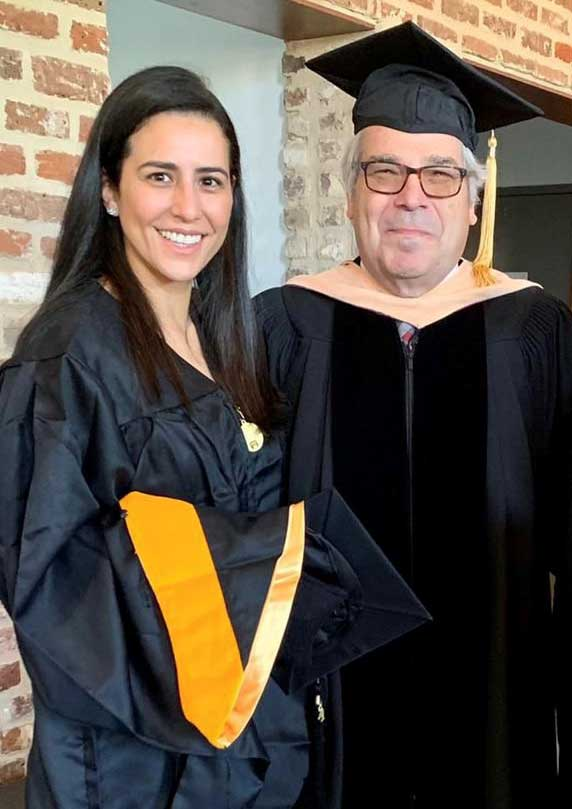 Dr. Clio Rubinos with one of her master's degree mentors, Dr. Daniel Lackland