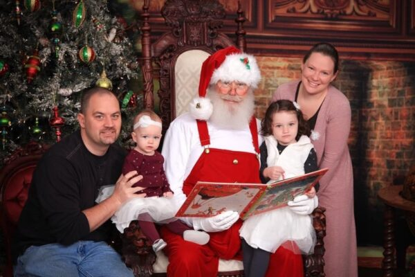 Photo of Chris Thompson and family with Santa