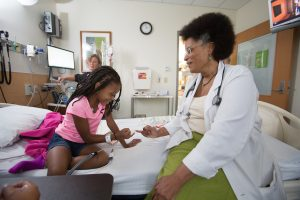 Dr. Rupa Redding-Lallinger with a patient.