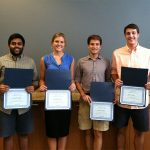 Carolina Summer Fellows with their Certificates of Completion, (from L to R) they are: Sainath Asokan, Jennifer Jensen, David Reich and Eric West. Photo by Betsy Clarke