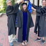 Dr. Amy Pomeroy, hooding ceremony, 2021 graduation with mentors, Dr. Henrik Dohlman and Dr. Tim Elston putting on her PhD hood at her hooding ceremony