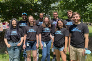 Group photo of 9 of 16 new graduate students who are joining the Pharmacology department on the lawn of the Genetic Medicine Building.
