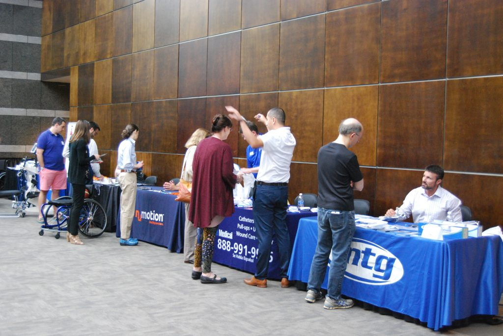 Attendees visit various exhibitor tables