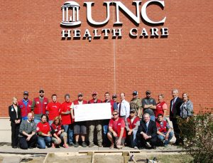 Lowe's Heroes present an in-kind check to the Center for Rehabilitation Care