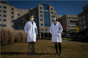 Photo of Drs Baratta and King in front of UNC Hospital