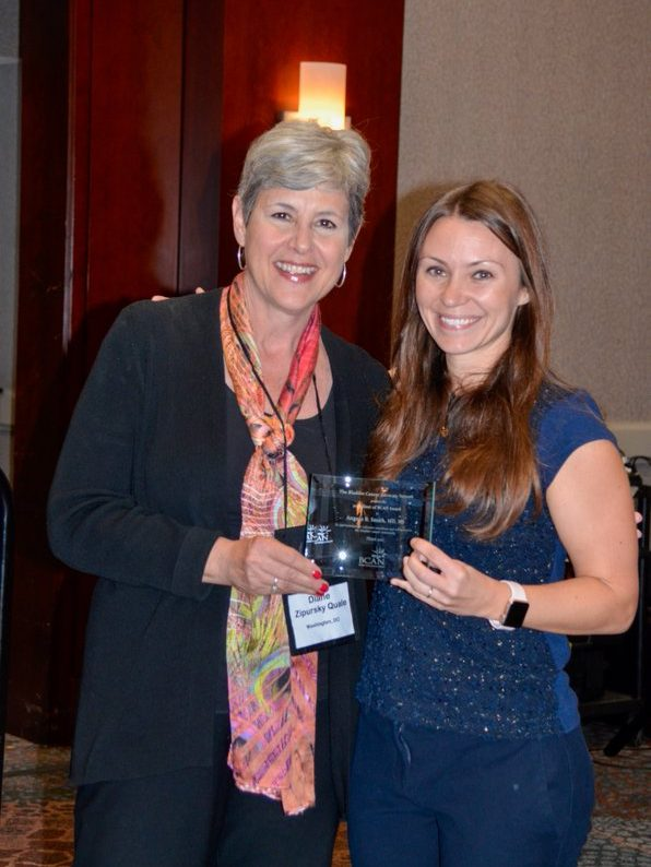 Dr. Smith accepts one of the 2019 Best of BCAN awards
